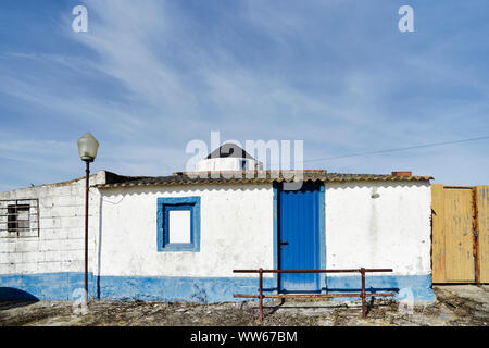 old windmill with wall, blue sky with clouds - Stock Photo