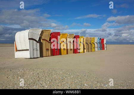 Beach chair parade on the beach of the North Sea island Juist. - Stock Photo