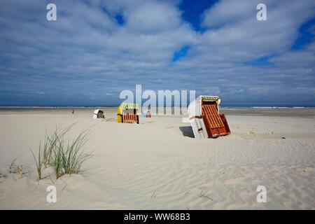 Beach chairs on the beach of the North Sea island Juist. - Stock Photo