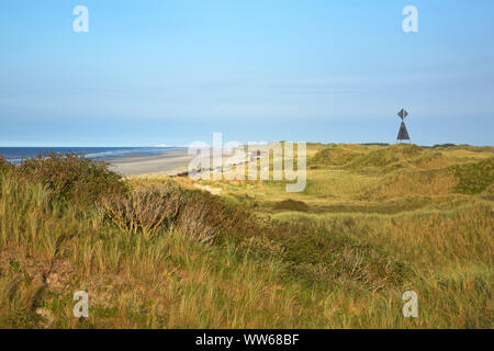 View of the Haaksdünen over the North Sea island Juist. On the right the west beacon. In the horizon the place Norderney. - Stock Photo