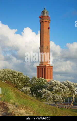 View from the dunes on the lighthouse of the island Norderney built in 1873. - Stock Photo
