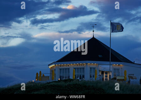Evening at the cafe Marienhöhe on the promenade on the west beach of the island Norderney. - Stock Photo