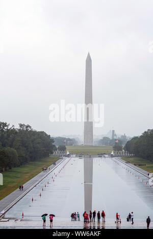 Washington DC, USA - June 9, 2019: Washington Monument on the Reflecting Pool in rainy day.