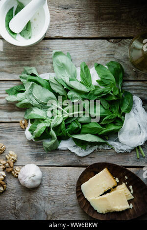 Basil pesto ingredients on wooden background. Top view composition, recipe flatlay - Stock Photo