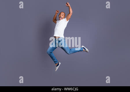 Full length body size portrait of his he nice handsome attractive muscular strong cheerful cheery crazy guy in white shirt jeans having fun great cool