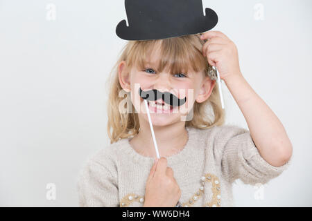 Child with tooth gap and mustache, portrait - Stock Photo