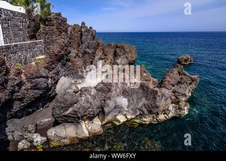 Italy, Sicily, Aeolian Islands, Stromboli, Stromboli, Piscita, rock formations - Stock Photo