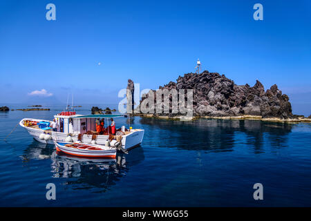 Italy, Sicily, Aeolian Islands, Filicudi, Scoglio La Canna, fishing boat - Stock Photo