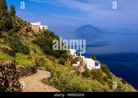 Italy, Sicily, Aeolian Islands, Alicudi, view at San Bartolo against Filicudi - Stock Photo