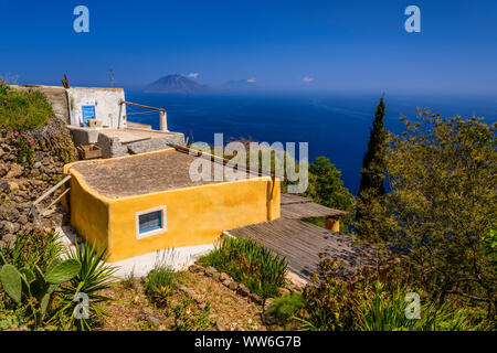 Italy, Sicily, Aeolian Islands, Alicudi, typical house in San Bartolo against Filicudi - Stock Photo