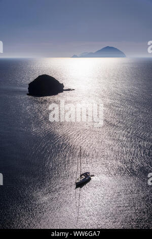 Italy, Sicily, Aeolian Islands, Salina, Pollara, Pollara Bay with Scoglio di Faraglione rocky island towards Filicudi - Stock Photo