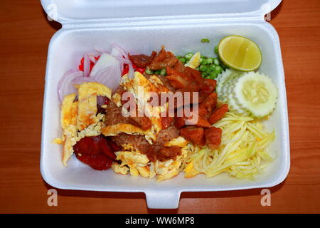 Fried rice mixed with shrimp paste, pork, sausage, egg, sliced mango and onion etc., street food in foam box. This is popular Thai food, it is called - Stock Photo