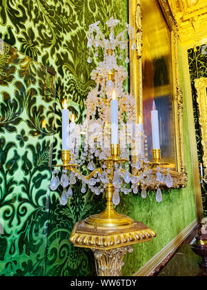 Paris / France - July 6, 2019: Vintage golden candelabrum in interior of Versailles Palace. - Stock Photo