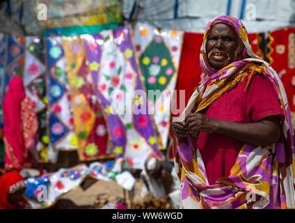 Eritrean woman selling their goods at the colourful monday market, Semien-Keih-Bahri, Keren, Eritrea - Stock Photo