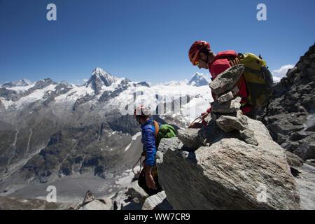 Climbing at the summit of Dent de Tsalion via Arolla, Val d'Hérens, Valais, Switzerland - Stock Photo