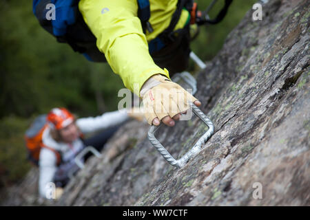 Climber on the via ferrata Nasenwand, Ginzling, Zillertal, Tirol, Austria - Stock Photo