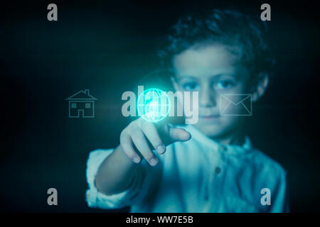 Child pressing the button, illuminated in blue, with the world wide web icon on a virtual screen. Photograph showing the concept of the use of technol - Stock Photo