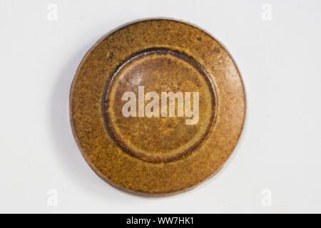round clay probe with tobacco glossy glaze - Stock Photo