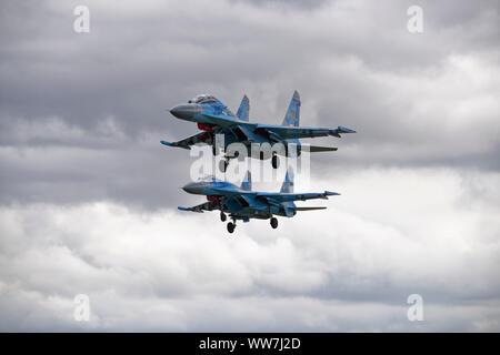 A pair of Sukhoi SU27 fighter aircraft of the Ukranian 831st Tactical Aviation Brigade arriving at RAF Fairford to participate in the RIAT - Stock Photo