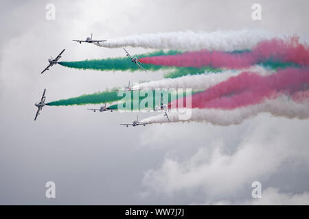 The Italian Air Force Military Aerobatic Display Team Il Frecce Tricolori in their Aermacchi AT-339A jet trainer aircraft put on a superb display. - Stock Photo