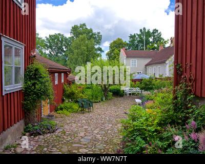 Sweden, Smaland, Eksjö, street inner courtyard in the old town - Stock Photo