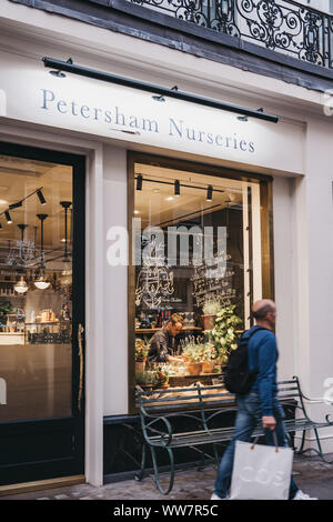London, UK - August 31, 2019: Man walking past Petersham Nurseries Deli in Covent Garden, London, UK. Covent Garden is a famous tourist area in London - Stock Photo