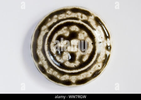 round clay sample covered assembly brown glossy glaze. Like drops, caramel, chocolate, brown with beige. - Stock Photo