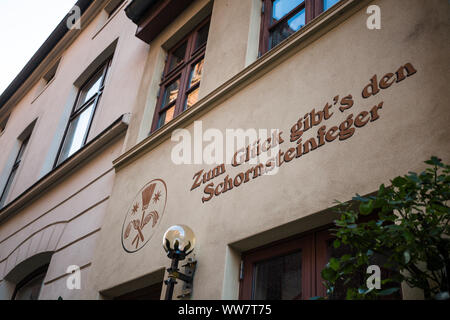 Germany, Wismar, facade painting chimney sweep - Stock Photo