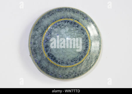 round clay sample covered crystalline blue glossy glaze. during firing, beautiful crystals grow. denim color - Stock Photo