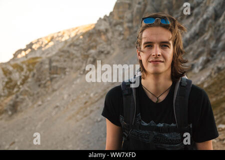 Young man on the way in the Bavarian mountains near Garmisch-Partenkirchen, - Stock Photo