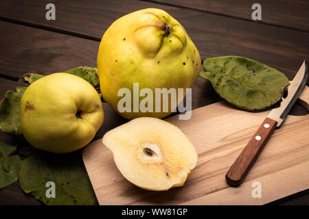 Fresh Quince fruit on wooden table. Cydonia oblonga - Stock Photo
