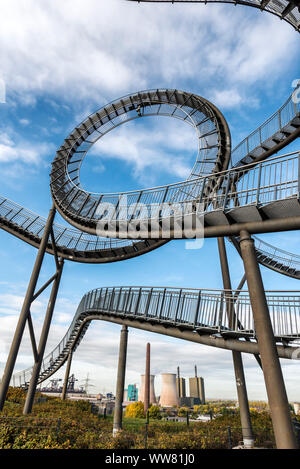 Duisburg, North Rhine-Westphalia, Germany, Landmark Tiger & Turtle - Magic Mountain in the background the gas power station Duisburg-Huckingen in the district Hüttenheim. Stock Photo