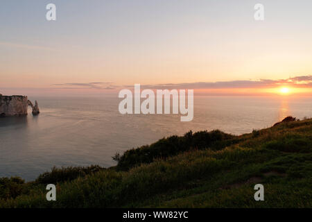 View to the rock needle L' Aiguille and Falaise d'Aval with Porte d'Aval in the sundown, Seine-Maritime, Etretat, Normandy, France - Stock Photo