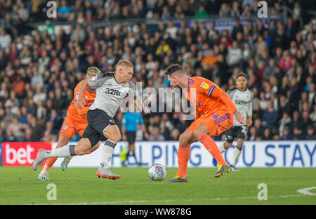Pride Park, Derby, East Midlands, UK. 13th Sep 2019. English Championship Football, Derby County Football Club versus Cardiff City Football Club; Martyn Waghorn of Derby County on the attack with the ball at his feet and gets past Sean Morrison of Cardiff City - Strictly Editorial Use Only. No use with unauthorized audio, video, data, fixture lists, club/league logos or 'live' services. Online in-match use limited to 120 images, no video emulation. No use in betting, games or single club/league/player publications Credit: Action Plus Sports Images/Alamy Live News - Stock Photo