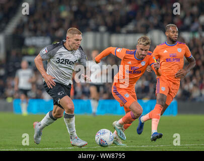 Pride Park, Derby, East Midlands, UK. 13th Sep 2019. English Championship Football, Derby County Football Club versus Cardiff City Football Club; Martyn Waghorn of Derby County on the attack with the ball at his feet chased by Sean Morrison of Cardiff City - Strictly Editorial Use Only. No use with unauthorized audio, video, data, fixture lists, club/league logos or 'live' services. Online in-match use limited to 120 images, no video emulation. No use in betting, games or single club/league/player publications Credit: Action Plus Sports Images/Alamy Live News - Stock Photo