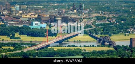 Aerial view, view from the west over the Rhine to the Beeckerwerth district in Duisburg, Rheinbogen with the Haus-Knipp railway bridge and the red motorway bridge. A42 motorway with two bridge piers, ThyssenSteel steel plant, Ruhrgebiet, North Rhine-Westphalia, Germany - Stock Photo