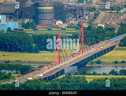 Aerial view, view from the west over the Rhine to the Beeckerwerth district in Duisburg, Rheinbogen with red motorway bridge A42 motorway with two bridge piers, steel mill ThyssenSteel, Ruhrgebiet, North Rhine-Westphalia, Germany - Stock Photo