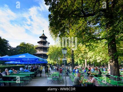 München, Munich, Biergarten am Chinesischen Turm (Beer garden at the Chinese tower) in Englischer Garten (English Garden), Upper Bavaria, Bavaria, Germany - Stock Photo