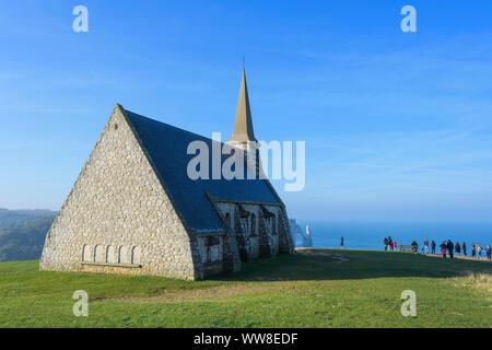 Chapelle Notre-Dame de la Garde chapel at sunrise, Etretat, Seine-Maritime Department, Atlantic Ocean, Normandy, France - Stock Photo