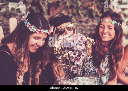 young women and girls in friendship all together celebrating and having fun in a bio natural place, smiles and laughing for group of hippies people alternative concept lifestyle - Stock Photo
