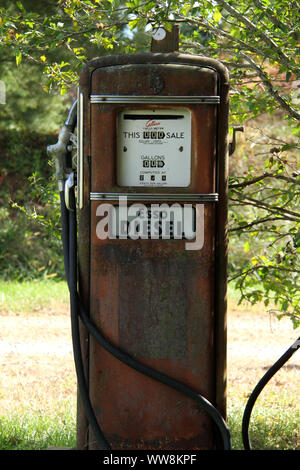 Out of use gas station pumps - Stock Photo
