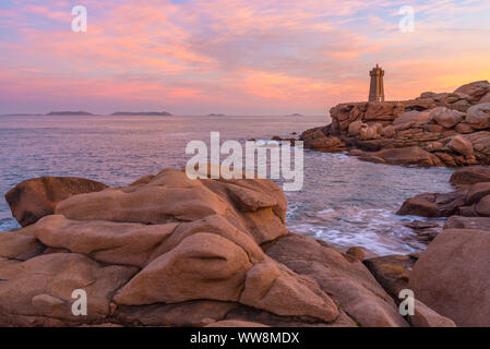 Lighthouse at sunrise Ploumanach lighthouse, Perros-Guirec, Ploumanach, Cote de Granit Rose,  Cotes-dArmor, Brittany, France, Europe - Stock Photo