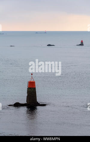 Beacon in sea at sunset, Pointe de Kermorvan, Le Conquet, Finistere, Brittany, France - Stock Photo