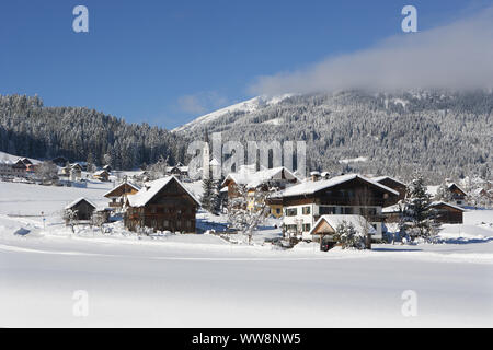View of Protestant church in winter, Gosau, Salzkammergut region, Upper Austria, Austria - Stock Photo