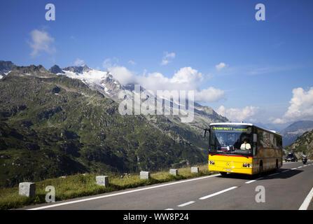 Swiss PostBus bus on Susten Mountain Pass Road, Uri Alps, Canton of Bern, Switzerland - Stock Photo