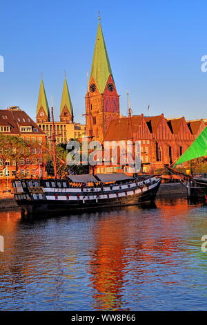 Historic sailing ship on the banks of the Weser river in front of the old town with Martinikirche and cathedral towers, Bremen, Land Bremen, Northern Germany, Germany - Stock Photo