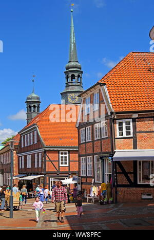 Pedestrian zone with half-timbered houses and church tower St. Cosmae in the Old Town, Hanseatic City of Stade, Lower Elbe, Altes Land, Lower Saxony, Northern Germany, Germany - Stock Photo