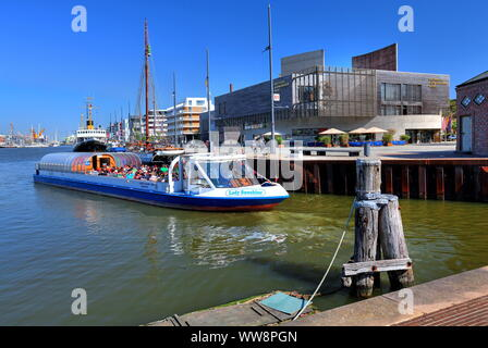 Harbour cruise ship in the New Harbour with German Emigration Centre, Bremerhaven, Wesermündung, Land Bremen, Northern Germany, Germany - Stock Photo