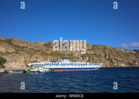 CHILE CHICO, CHILE - FEBRUARY 21, 2016: Police boat and ferry in the port of Chile Chico, Chile on February 21, 2016. - Stock Photo