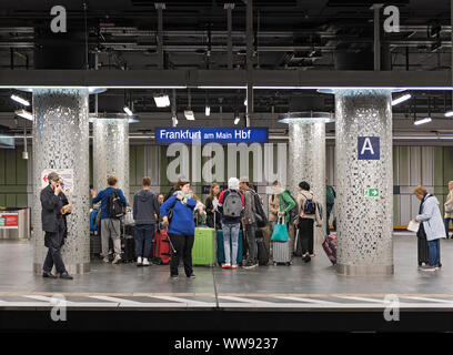 people are waiting for the train in the subway station frankfurt am main central - Stock Photo
